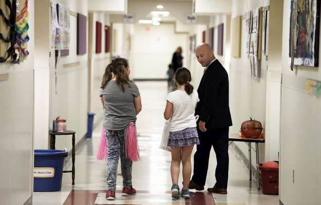 Superintendent in Hallway with students